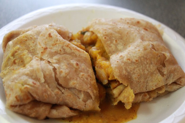 Curry shrimp roti with squash in whole wheat paratha.