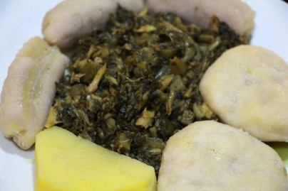 Callaloo and saltfish dinner complete with 'food,' otherwise known as side dishes that commonly include starches of boiled dumpling, boiled banana, yam or cassava.