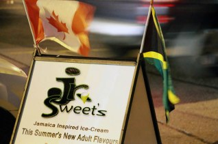 "When Claude Fearon, owner of JR Sweet's Jamaican Inspired Ice Cream, was growing up in Sandy Bay, Jamaica, Sunday night dessert always meant a slice of his mother's freshly-baked black cake or carrot pudding, paired with a scoop of rum raisin ice cream. ""That was our staple,"" says Fearon. ""Those are the things that I remember as a kid, and a lot of the people that walk in the door feel like they're a kid again in Jamaica. It makes them feel good."" Fearon opened JR Sweet's, in Toronto's Oakwood-Vaughan neighborhood, in May 2014 with a vision to share a facet of his culture that was being overlooked. Toronto's Jamaican community includes numerous places to feast on jerk chicken and curry goat, but nowhere else that specializes in the island's unique ice-cream flavors. ""In Jamaican culture, we have a lot of desserts and it runs pretty deep,"" Fearon says. ""I want to bring that to Toronto in a more detailed fashion."" Fearon works with different suppliers to offer a vast array of ice cream flavors, including Coconut Rum, and incredibly rich variations on classics like Stout, Mango, Soursop and Grapenut. There are a few unexpected twists like Tequila Lime and Kahlua, but the standard choice is nostalgic like Sunday nights in Sandy Bay: an outstanding Rum Raisin. Loaded with the dried fruit and fragrant like an aged barrel of Appleton, it's unequivocal. Fearon isn't stopping at hype of obtaining exotic delicacies, and sees JR Sweet's as ""progressive business."" He plans to change formulas to produce a more authentic Soursop flavor, and introduce nesberry, a tangy-sweet fruit from Jamaica. After closing for the season in September, JR Sweet's re-opened on Father's Day, with additional cakes, pastries and Jamrock-inspired frozen yogurt."